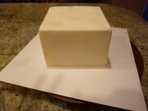 covering heart ball cake in fondant