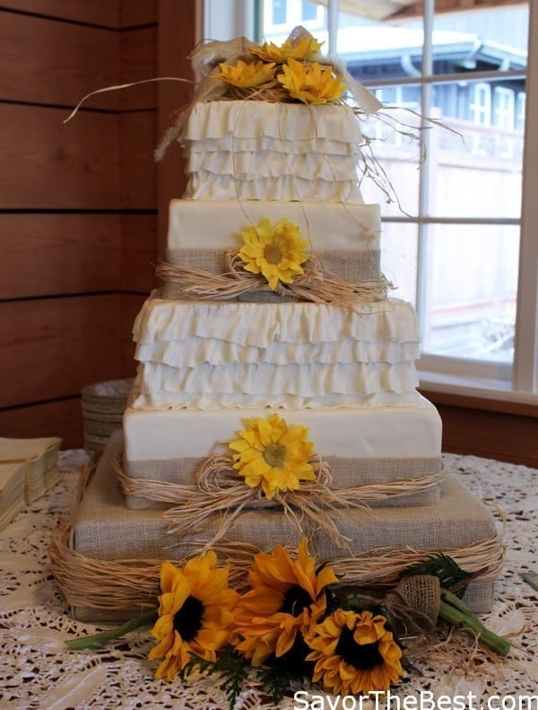 Country themed Cake with boots on top! @Debra Eskinazi