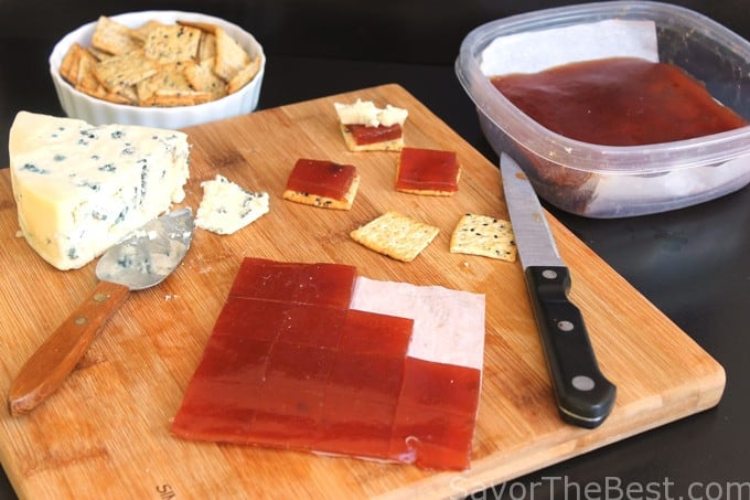 Pear Paste on a cutting board with crackers and cheese