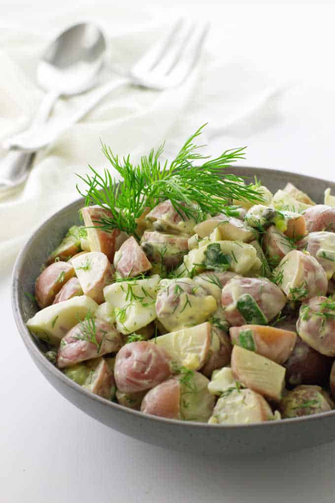 large bowl of potato salad with fresh dill