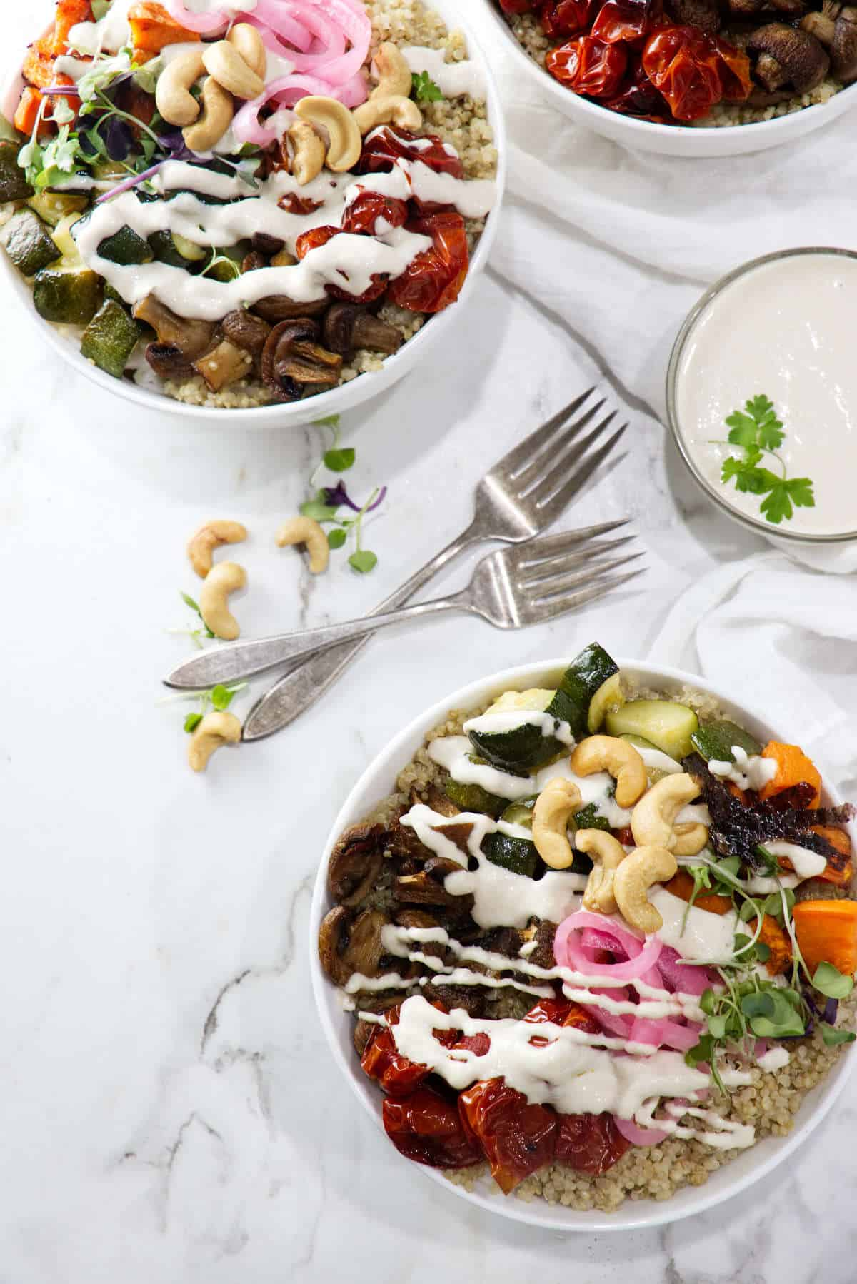 Roasted veggie quinoa bowl with tahini cashew sauce