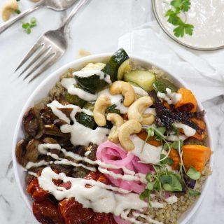 Roasted veggie quinoa bowl with tahini cashew sauce