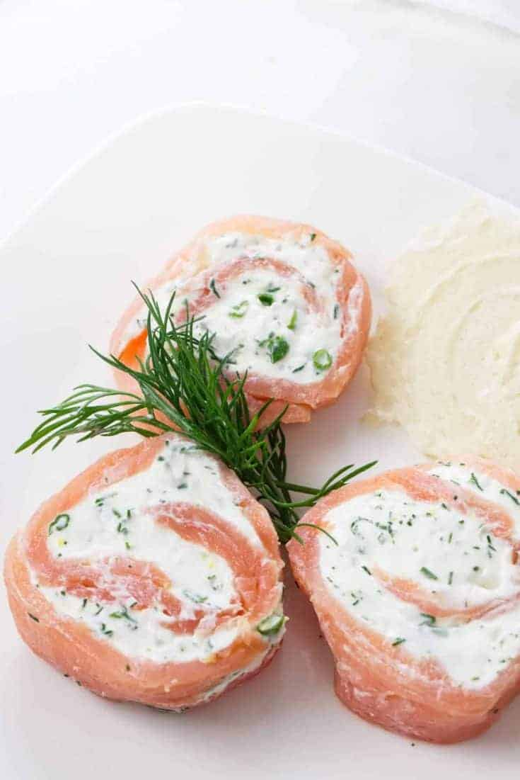 These smoked salmon pinwheels have a soft, creamy filling with a hint to fresh dill and lemon.  They are a great addition to a cheese and cracker tray.  These party pleasers can be made in advance to save you time on the day of your dinner party.