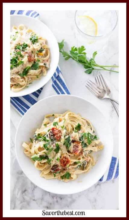 Fettuccini pasta is combined with roasted tomatoes and spinach then smothered in a creamy, smooth cashew cream sauce.