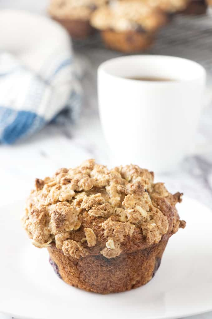 A healthy banana blueberry muffin and a cup of coffee