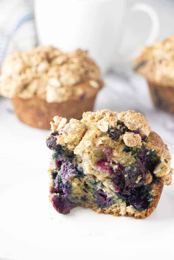 a healthy banana blueberry muffin split in half