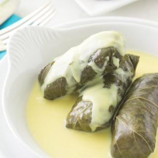 Lamb Stuffed Grape Leaves (Dolmas) with Avgolemono Sauce