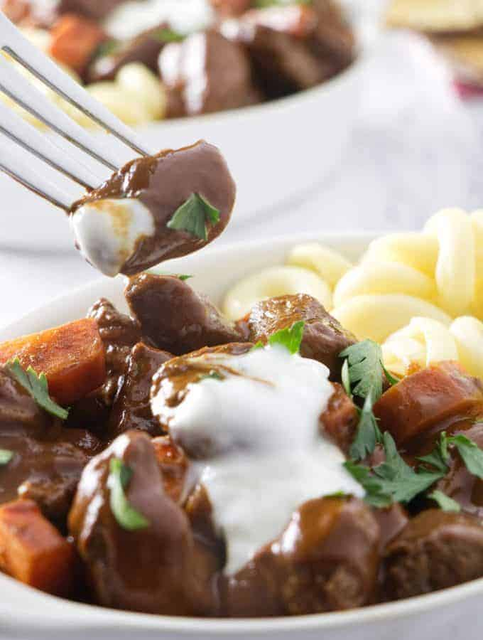 Taking a bite of a tender chunk of venison goulash