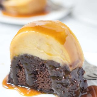 Slice of chocoflan cake covered in caramel syrup