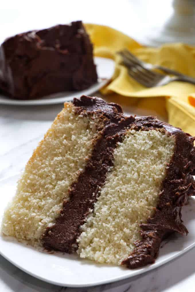 slice of yellow cake with chocolate frosting
