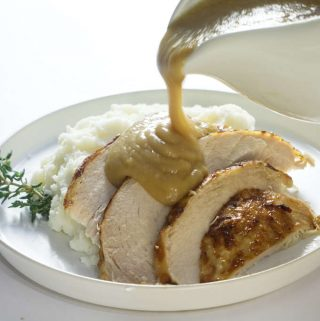 Instant pot frozen turkey breast sliced and served with gravy