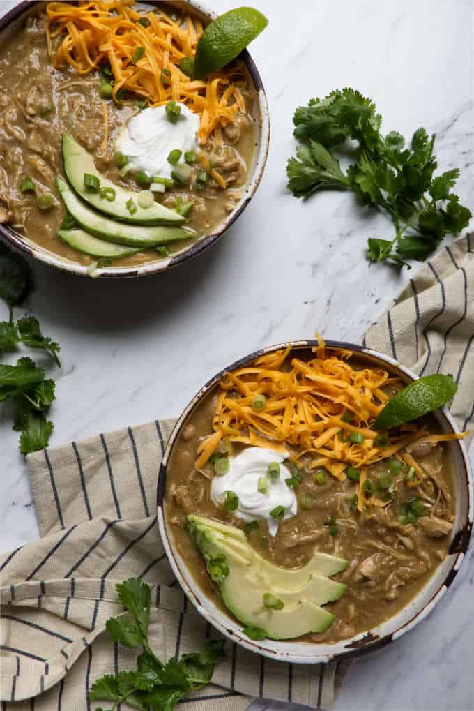 two bowls of instant pot white chicken chili
