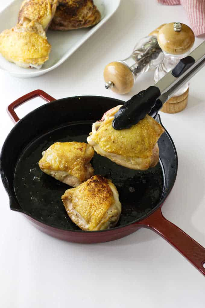 Chicken browned in a skillet