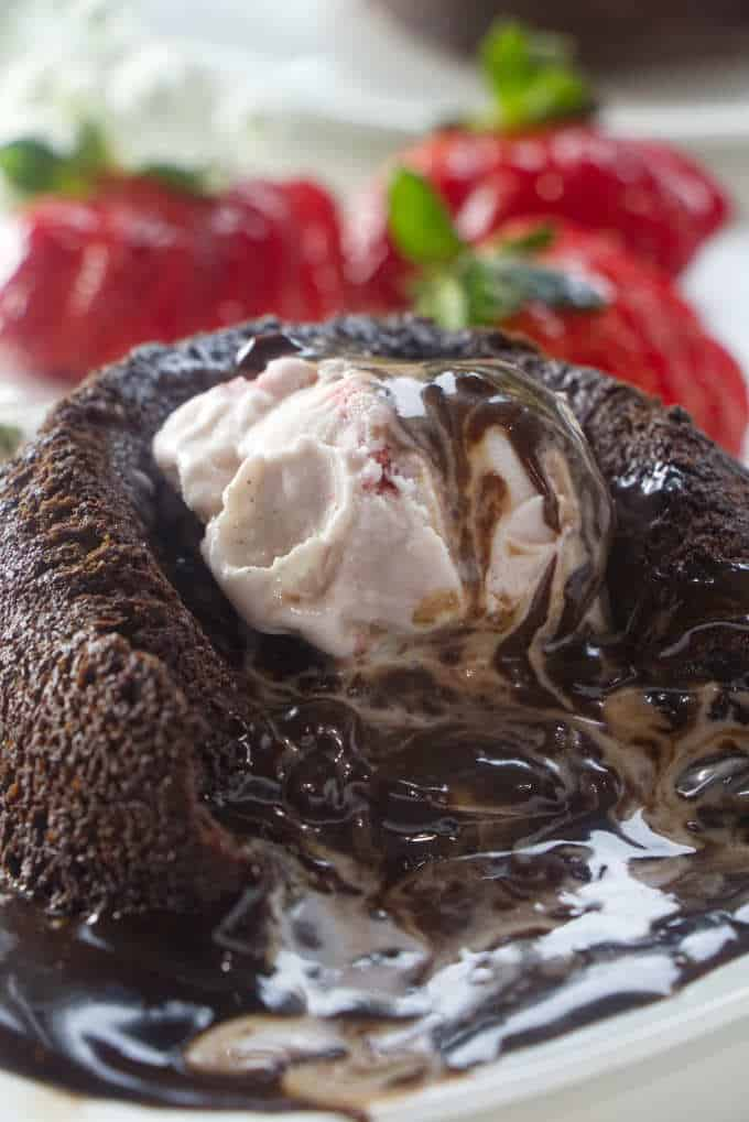 Ice cream melting into the chocolate lava cake