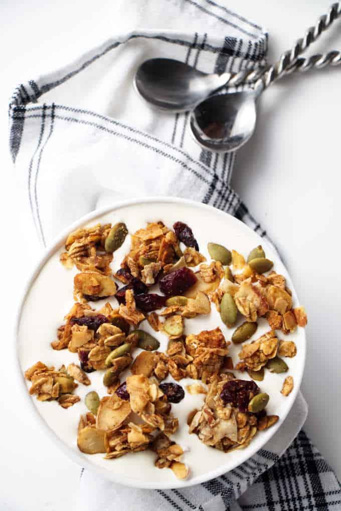 ancient grains apple cranberry granola in a bowl of yogurt