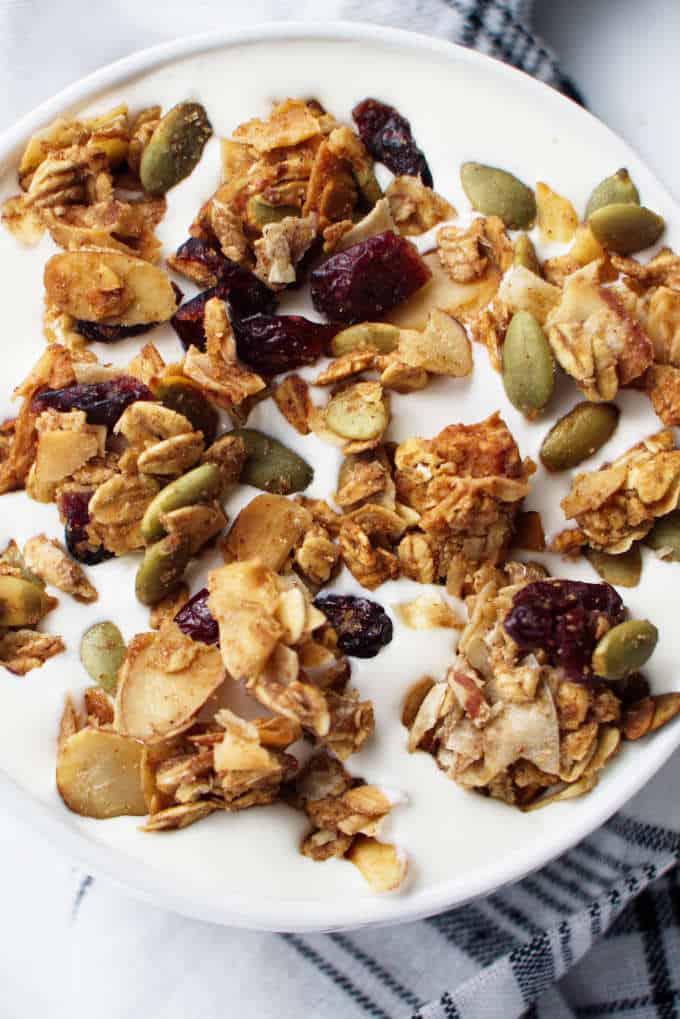 ancient grains apple cranberry granola in a bowl of granola