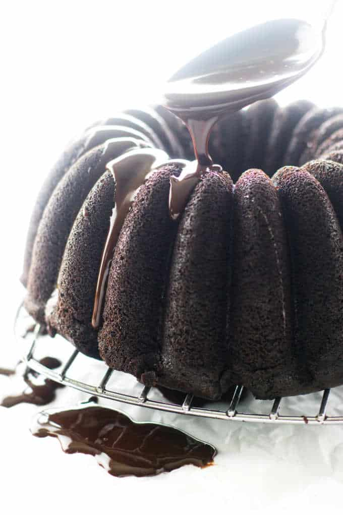 Chocolate Bundt Cake being drizzled with ganache