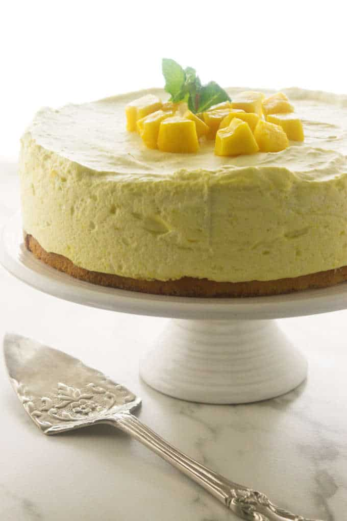 Mango Mousse Cake on a cake stand