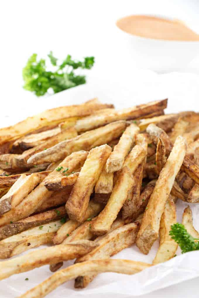 air fried French fries with sauce in the background