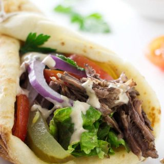 close up of a beef shawarma sandwich wrap