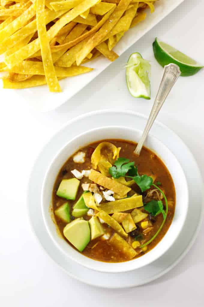 overhead view of chipotle chicken tortilla soup with tortilla strips