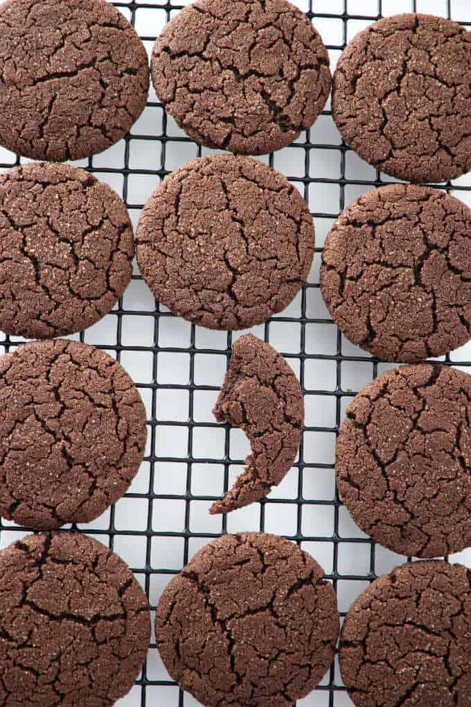 a dozen sugar cookies on a cooling rack
