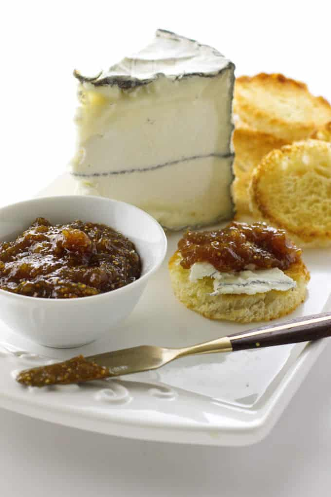 fig jam with cheese and bread on a plate