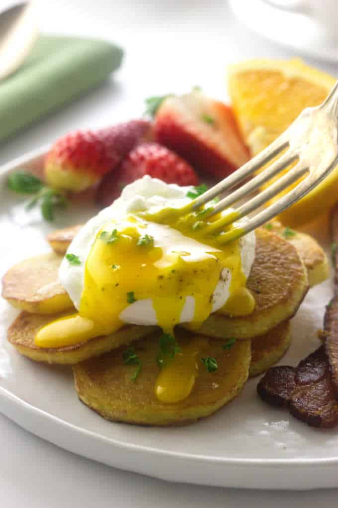 crispy potato slices with an egg on top