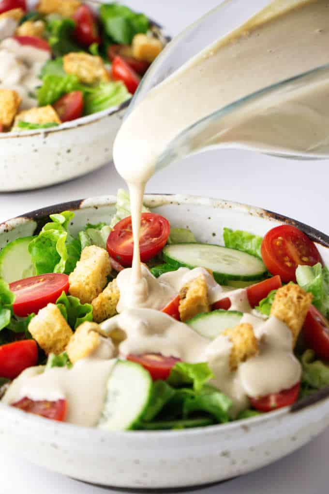 Tangy, creamy tahini dressing on a tossed salad