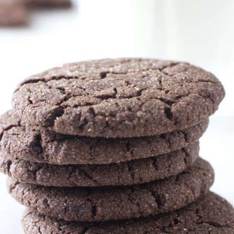 five chocolate cookies stacked on each other