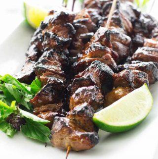 close up of pork satay skewers