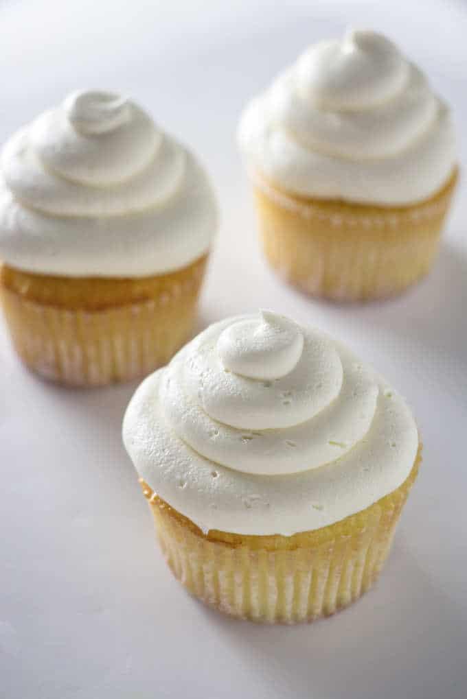3 cupcakes with vanilla buttercream