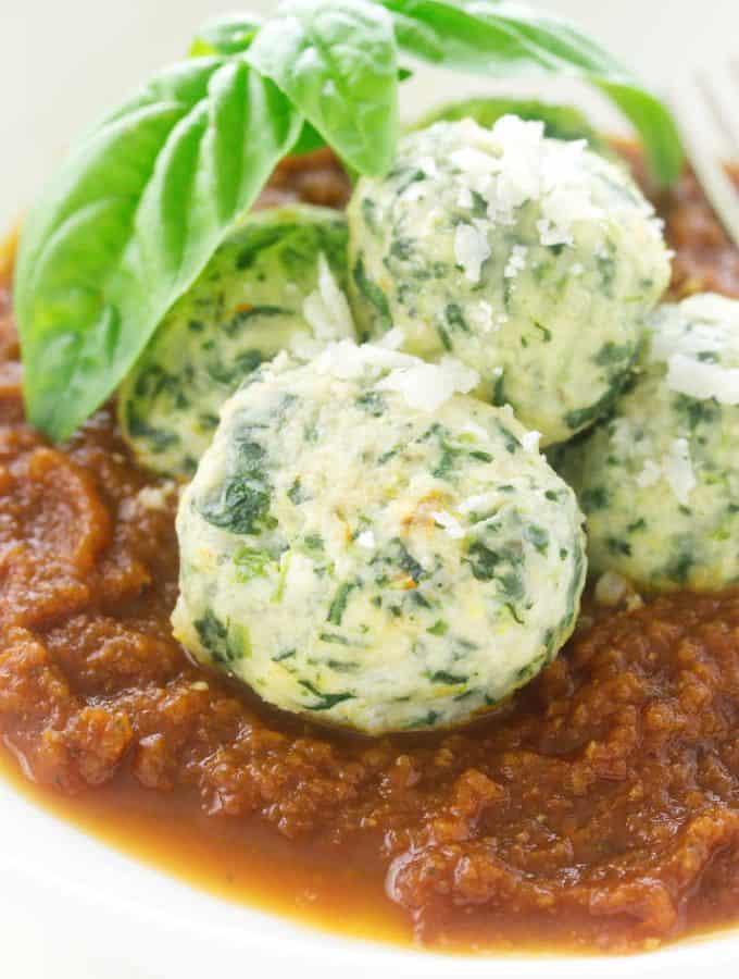 Close-up of malfatti and tomato sauce