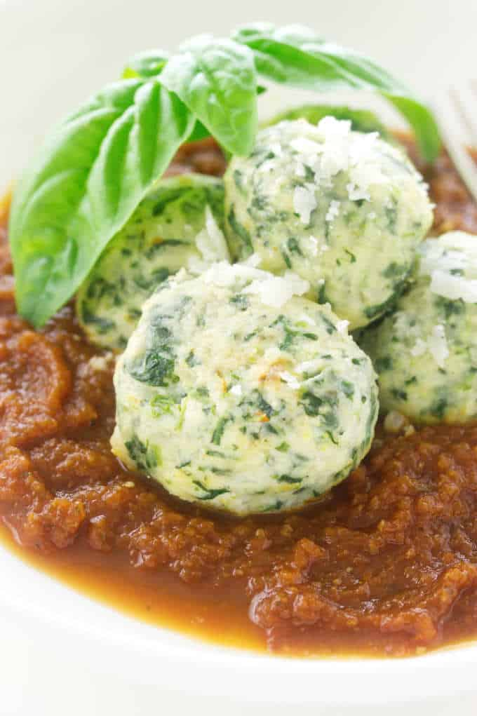 Close-up of malfatti and tomato sauce