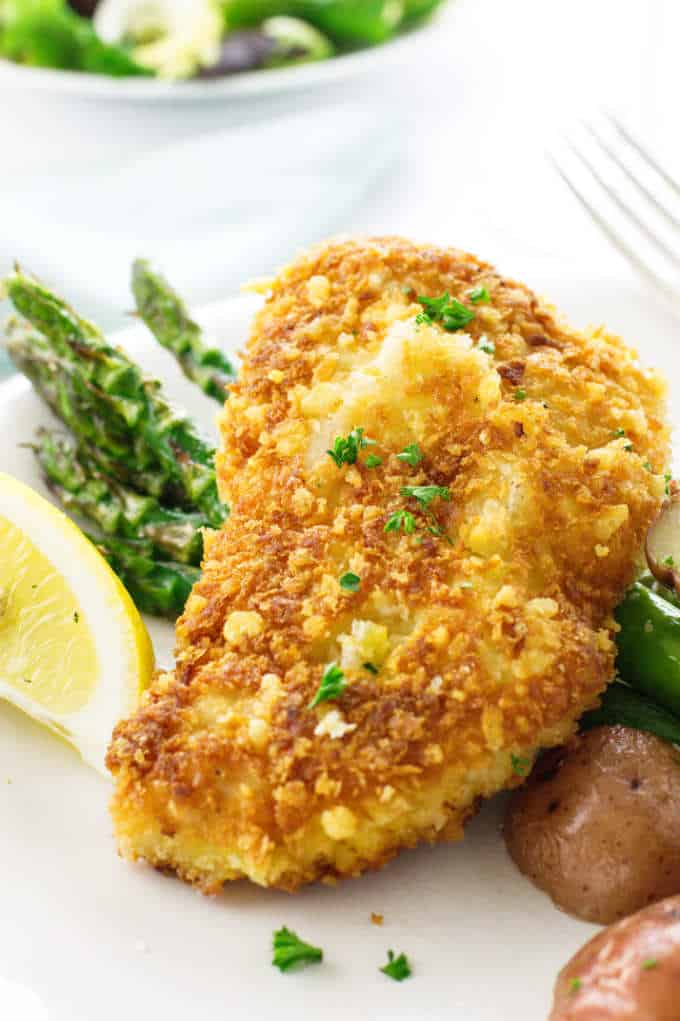 Parmesan Crusted Chicken on a plate with vegetables