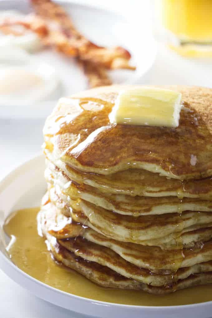 stack of sourdough pancakes with a pat of butter on top