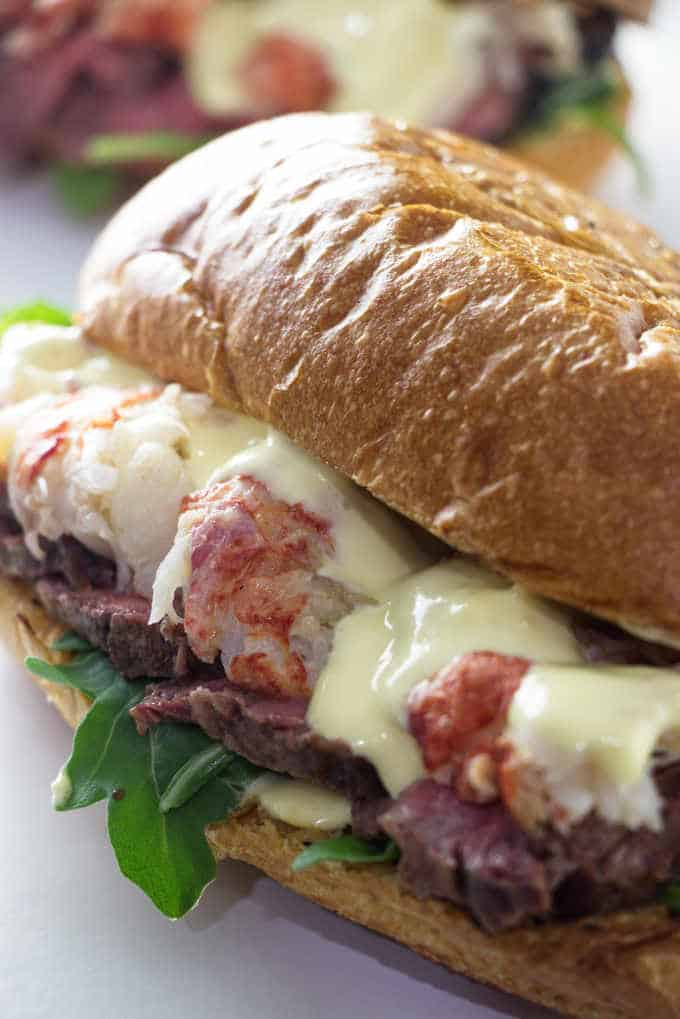 close up of steak and lobster sandwich