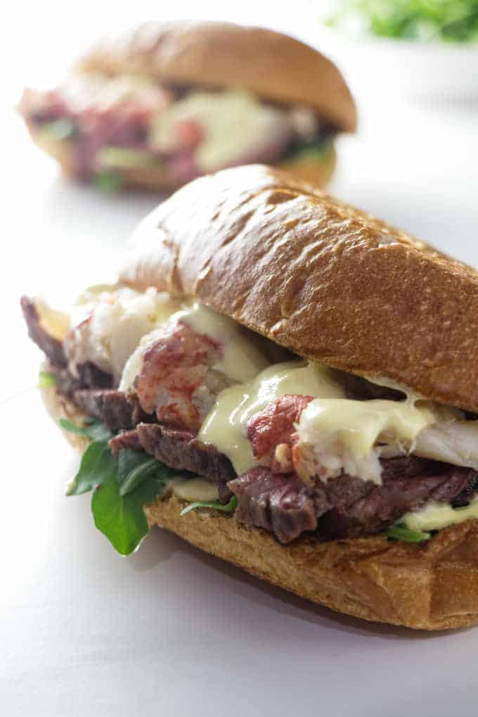 two steak and lobster sandwiches