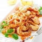 Serving plate with shrimp and lemon wedges