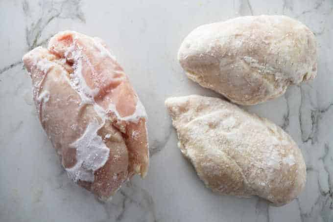 Chicken breasts frozen in a large clump next to chicken breast frozen individually