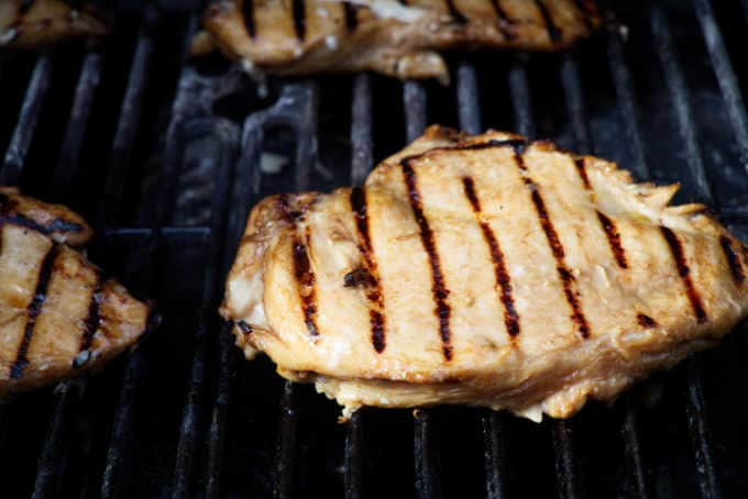 a chicken breast on a hot grill
