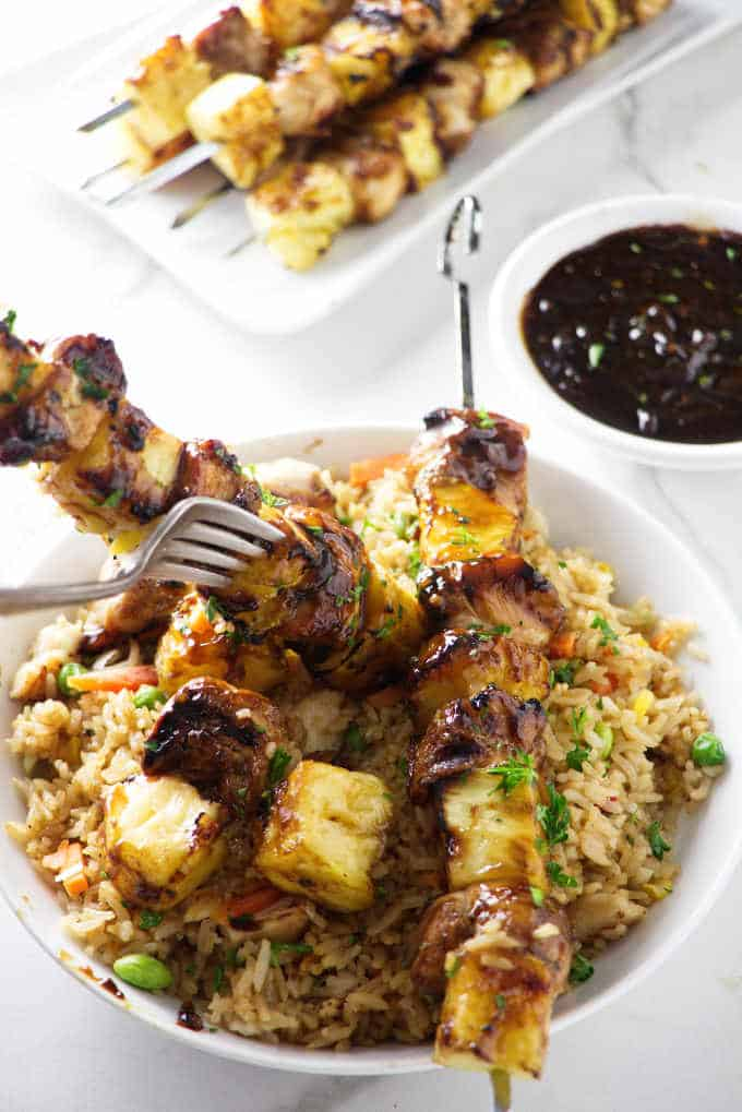 grilled pineapple chicken kabobs served with fried rice