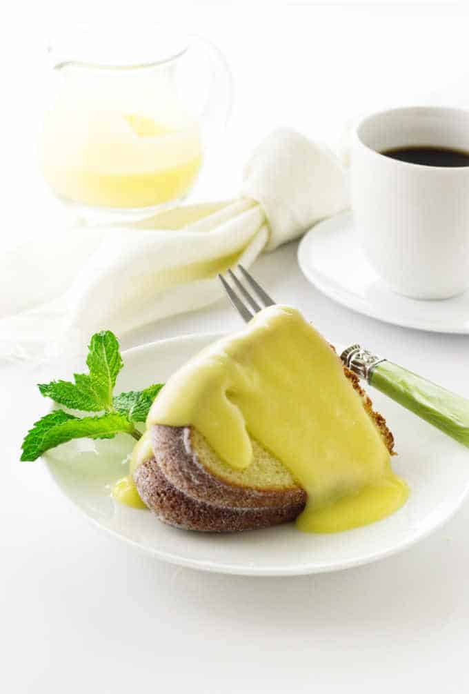 Creamy lemon sauce on a slice of cake