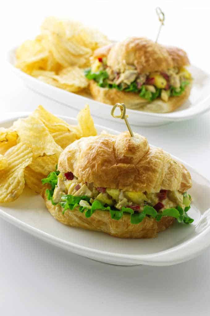 Brioche buns filled with pineapple, chicken mixture with potato chips on the side