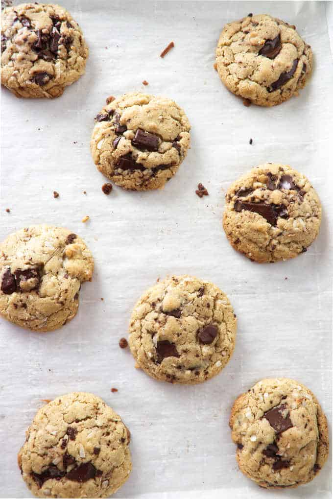 overhead picture of tahini chocolate chunk cookies cooling on a baking sheet