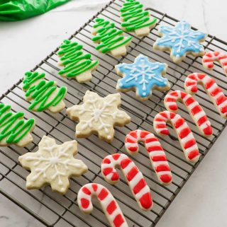 a cooling rack with decorated sugar cookies