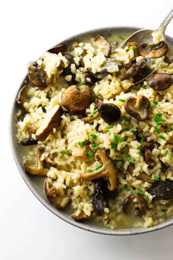 Over head photo of a bowl, spoon and mushroom risotto