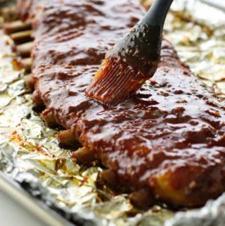 Pork ribs being brushed with glaze