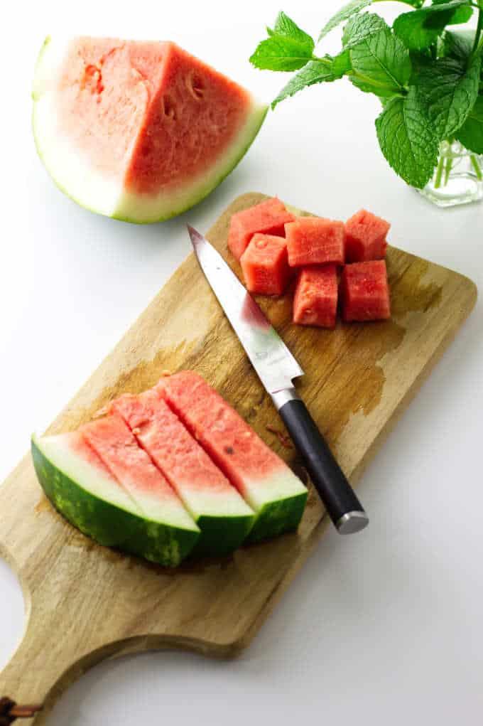 Watermelon, mint, knife and cutting board