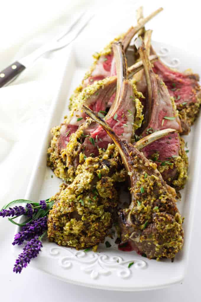Overhead view of platter of lavender pistachio crusted lamb